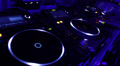 Dj spinning platter on turntable, tweaking controls on the deck Footage