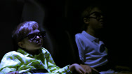 Stock Video Footage of boys in 3d stereo glasses sit at cinema