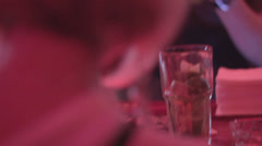 Stock Video Footage of Pretty woman sitting alone in bar, drinking cocktail at party