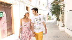 Happy couple walking in the streets of ibiza Stock Footage