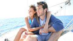 happy couple navigating on sailboat - stock footage