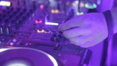 Dancing crowd enjoying party, dj tweaking controls on deck, click for HD Stock Footage