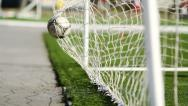 Stock Video Footage of SLOW: Soccer ball flies into the football goal