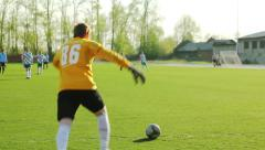 Goalkeeper kicks them out of the ball Stock Footage