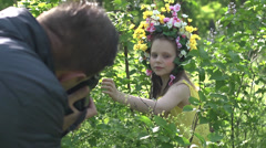 Girl model undergoes photographing in the park Stock Footage