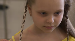 Weaving braids - ribbon in her hair Stock Footage