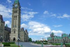 clock tower in a parliament building, peace tower, centre block, parliament h - stock photo