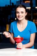 Girl enjoying tempting dessert Stock Photos