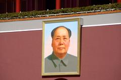 A painted portrait of Chairman Mao Zedong outside his mausoleum - stock photo