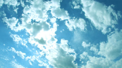 Beautiful cloudscape with white fluffy  clouds and sunshine Stock Footage