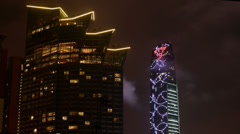 Jingji 100 building and floating cloud at night in Shenzhen Stock Footage