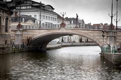 arch bridge across a river, saint michael's bridge, river lys, ghent, belgium - stock photo
