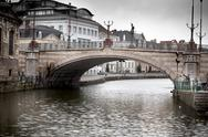 Stock Photo of arch bridge across a river, saint michael's bridge, river lys, ghent, belgium