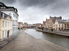 buildings along a river, river lys, ghent, belgium - stock photo