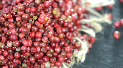 Heap of pink peppercorns (loopable) Stock Footage