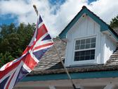 Stock Photo of british flag fluttering in front of an old building