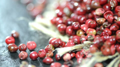 Pink peppercorns (loopable) Stock Footage