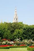 Vienna's Rathaus (City Hall) beyond Volksgarten park - stock photo