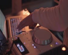 Deejay's hands playing set at party, nightclub atmosphere, click for HD Stock Footage