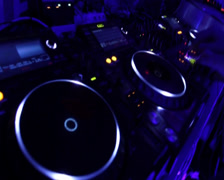 Dj spinning platter on turntable, tweaking controls on the deck, click for HD Stock Footage