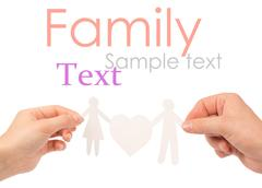 paper family in hands isolated on a white background - stock illustration