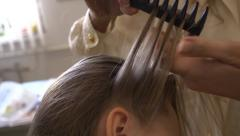 Making hairstyles for little girl Stock Footage