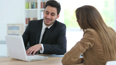 Woman meeting financial adviser in office Stock Footage