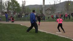 Softball game young girls hit and run 4K 047 Stock Footage