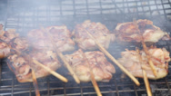 Stock Video Footage of Grilled chicken meat are cooked in the market, Thailand.