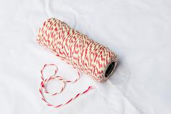 red and white baker's twine spool - stock photo