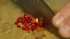 Stock Video Footage of Close up shot chopping red chillies with knife