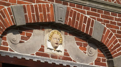 Graft City hall, built in 1613 - close up brick facade with angel head plaque Stock Footage
