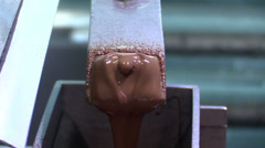 Pouring chocolate in a chocolate factory in Cologne Stock Footage