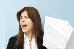 Beautiful business woman screaming and stressing over work Stock Photos