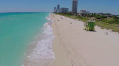 Aerial video low beach flyover Stock Footage