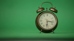 Alarm clock on a green background Stock Footage