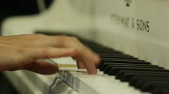 A man in an overwhites plays on fortepiano Stock Footage