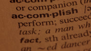Stock Video Footage of Word Accomplish in a dictionary