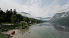 Bohinj Lake with Julian Alps in the background - pan Stock Footage