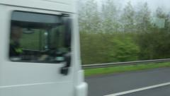 overtaking white lorry driving on motorway in england - stock footage