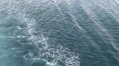 Foamy waves behind ship, ferry boat trail, yacht, sea blue water, waveform Stock Footage