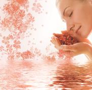 Beautiful young woman with a hanful of aromatic berries reflected in rendered Stock Illustration