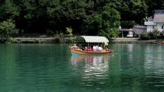 Tourist boat on the Bohinj Lake, Slovenia Stock Footage