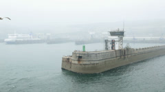 Misty weather at breakwater at harbour entrance, dover, england Stock Footage