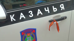 The St. George ribbon on the handle of the car Stock Footage