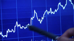 Businessman use pen touch Stock Market Graph on computer screen. Stock Footage