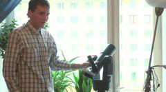 Astronomer configures the telescope Stock Footage