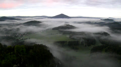 Spring morning view into foggy valley below view point in Bohemian Switzerland Stock Footage