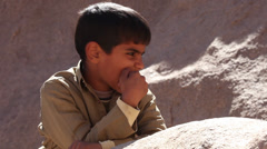 Boy looks around in the desert, Hurghada, Egypt Stock Footage