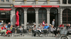 People sit at cafe in grote markt, antwerp, belgium Stock Footage